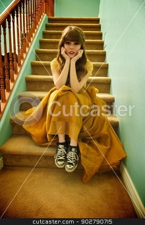 Teen Girl With Formal Prom Gown and Sneakers stock photo, Teen girl sits on staircase wearing her formal prom gown and her ratty, old sneakers by Shane Morris