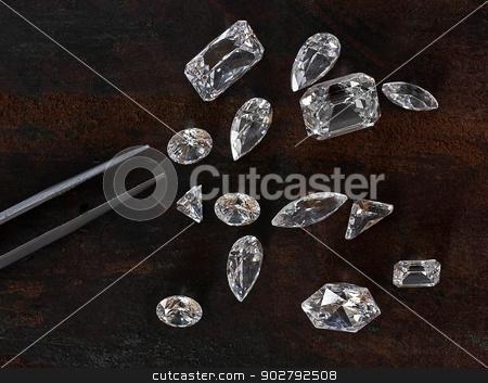 diamonds and tweezers stock photo, few diamonds over leather background and a tweezers by RedDaxLuma