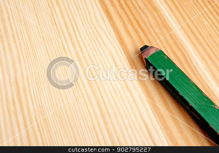 Closeup of green carpenter pencil stock photo, Closeup of green carpentry pencil on wood with copy space by Sarah Marchant