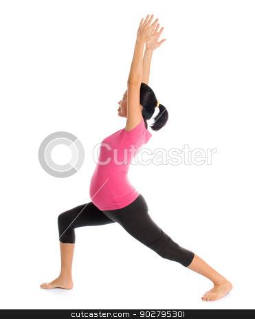 pregnant yoga pose stock photo