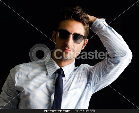 Attractive, elegant young man with shirt, tie and sunglasses stock photo, Handsome, elegant young man with shirt, tie and sunglasses, one hand on his head, isolated on black by Stefano Cavoretto