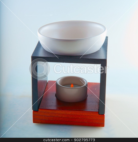 Essence burner stock photo, Essence burner in close up with lit candle by Fabio Alcini