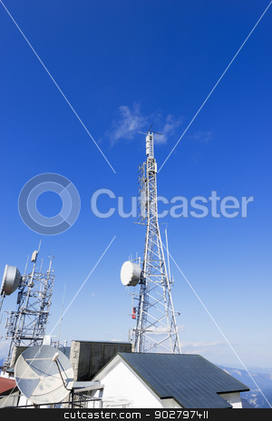 Telecommunication Towers on Blue Sky stock photo, Two communication towers on the roof with a beautiful blue sky by catalby
