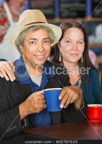 Happy Couple in Cafe stock photo, Smiling mixed couple together in coffee house by Scott Griessel