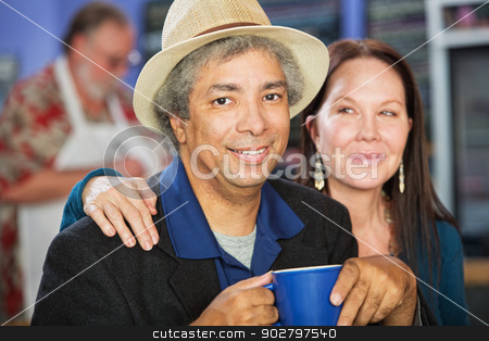 Happy Couple in Restaurant stock photo, Cheerful mixed couple together in coffee house by Scott Griessel