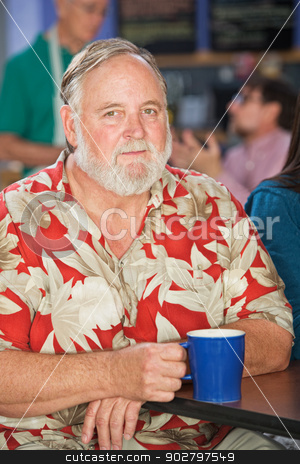 Grinning Mature Man stock photo, Grinning mature man sitting in cafe with coffee by Scott Griessel