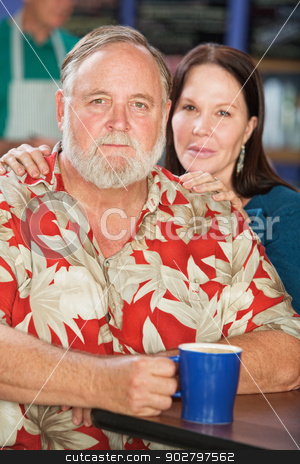 Attractive Couple in Cafe stock photo, Attractive middle aged couple with coffee in cafe by Scott Griessel