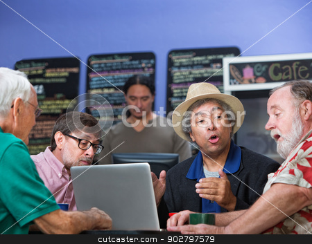 Group of Four Men Talking stock photo, Mixed group of four mature men talking in cafe by Scott Griessel