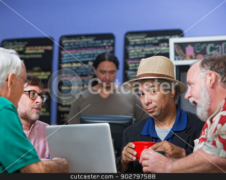 Diverse Men Talking stock photo, Diverse group of four mature men talking in cafe by Scott Griessel