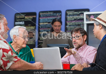 Group of Men in Conversation stock photo, Mixed group of men in cafe having a conversation by Scott Griessel
