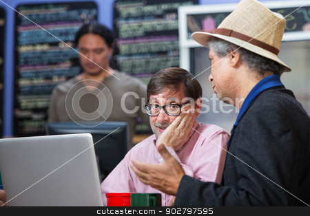Man with Hand on Cheek stock photo, Mature man with hand on cheek in a coffee house by Scott Griessel