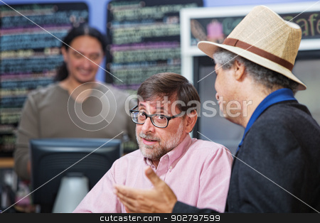 Doubtful Man with Friend stock photo, Doubtful man with friend in a coffee house by Scott Griessel