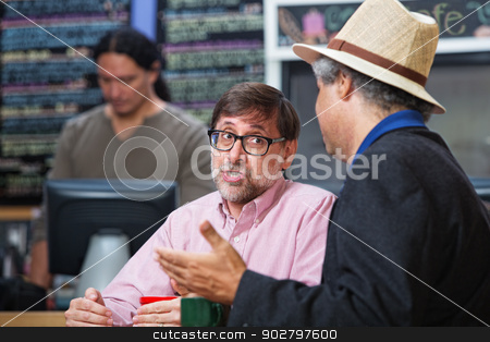 Pair of Men in Cafe stock photo, Pair of men talking in a cafe by Scott Griessel