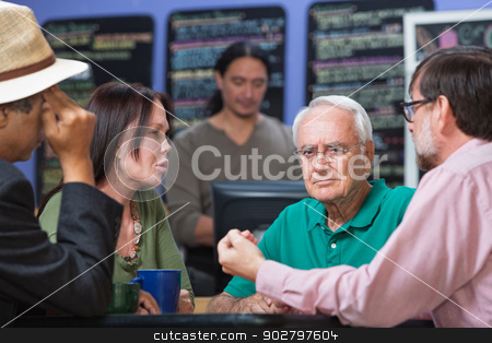 Frowning Man in Coffee House stock photo, Frowning man with concerned friends in coffee house by Scott Griessel