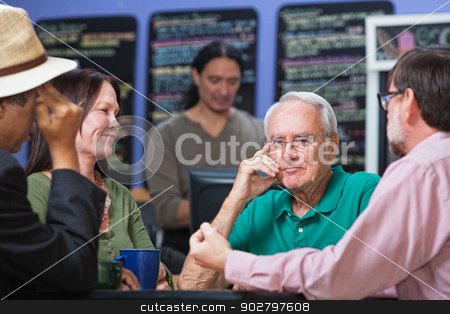 Pensive Man with Concerned Friends stock photo, Pensive handsome Caucasian male with friends in cafe by Scott Griessel