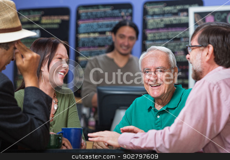 Happy Man with Friends stock photo, Laughing senior man with group of friends in restaurant by Scott Griessel