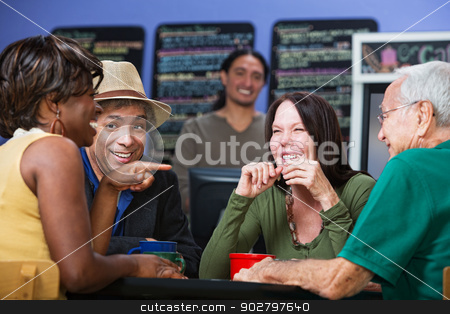 Merry Adults in Cafe stock photo, Joyful group of adults sitting in a cafe by Scott Griessel