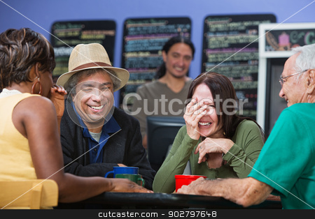 Diverse People Sharing Jokes stock photo, Diverse group of adults joking in a coffee house by Scott Griessel