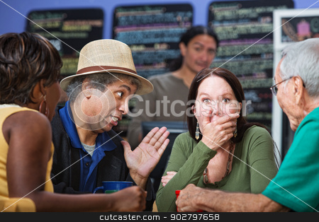 Embarrassed Woman in Group stock photo, Embarrassed woman with hand on mouth with group in cafe by Scott Griessel