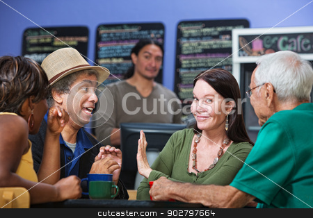 Woman Showing Man Her Hand stock photo, Woman gesturing man in cafe to stop talking by Scott Griessel