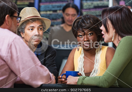 Gorgeous Woman in Cafe stock photo, Gorgeous Black woman with diverse group in cafe by Scott Griessel