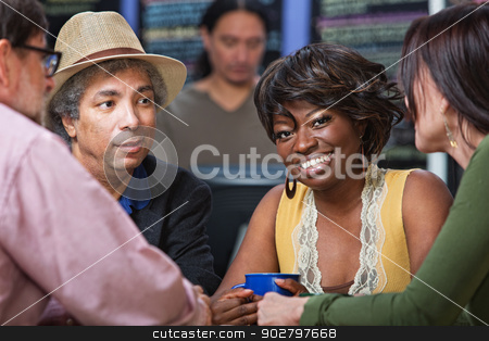 Cheerful Woman with Friends stock photo, Cheerful woman with group in coffee house by Scott Griessel