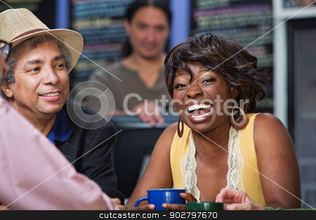 Laughing Lady in Cafe stock photo, Diverse group of men and women laughing in restaurant by Scott Griessel