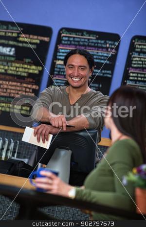 Handsome Restaurant Waiter stock photo, Handsome Latino waiter behind counter at restaurant by Scott Griessel