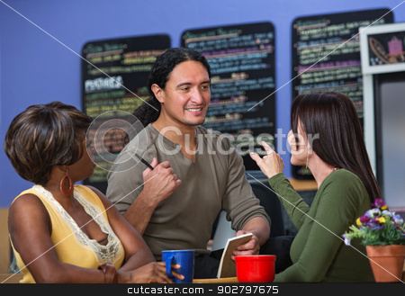 Ladies Ordering from Waiter stock photo, Pretty women ordering from server at a cafe by Scott Griessel