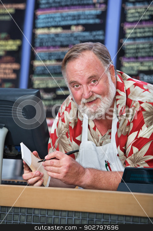 Grinning Cafe Worker Taking Orders stock photo, Grinning man in beard and mustache working at a cafe by Scott Griessel