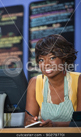 Cute African Bistro Owner stock photo, Beautiful cafe worker taking orders on receipt book by Scott Griessel
