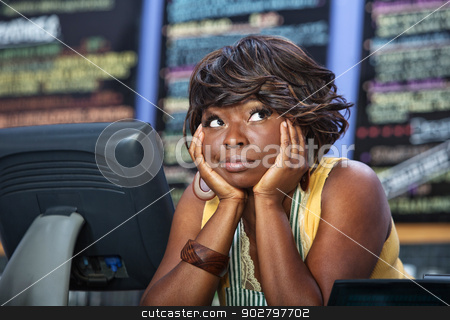 Bored Waitress Looking Up stock photo, Beautiful cafe owner with hands on cheeks looking up by Scott Griessel