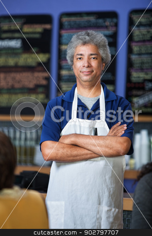 Attractive Cafe Waiter stock photo, Confident mature Arab cafe waiter with apron by Scott Griessel