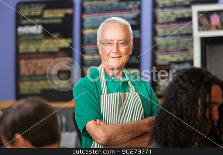 Independent Coffee House Owner stock photo, Independent older cafe employee with striped apron by Scott Griessel