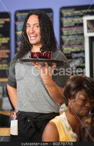 Cheerful Restaurant Owner stock photo, Happy Native American cafe owner serving drinks to customers by Scott Griessel