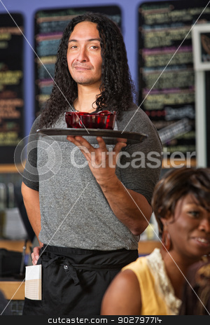Confident Cafe Owner stock photo, Male Hispanic cafe waiter serving drinks to customers by Scott Griessel