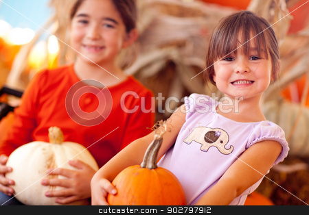 Cute Little Girls Holding Their Pumpkins At A Pumpkin Patch stock photo, Cute Little Girls Holding Their Pumpkins At A Pumpkin Patch One Fall Day. by Andy Dean