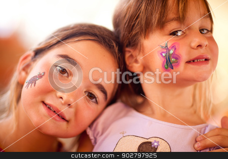 Cute Girls Showing Their Face Painting At A Party stock photo, Cute Little Girls Showing Their Face Painting At A Party. by Andy Dean