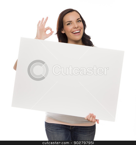 Smiling Mixed Race Female Holding Blank Sign on White stock photo, Beautiful Mixed Race Female Holding Blank Sign Isolated on a White Background Giving OK Gesture.  by Andy Dean