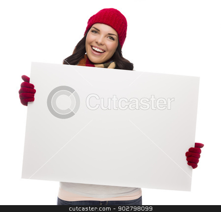 Excited Girl Wearing Winter Hat and Gloves Holds Blank Sign  stock photo, Excited Girl Wearing Winter Hat and Gloves Holds Blank Sign Isolated on White Background. by Andy Dean
