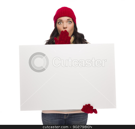 Stunned Girl Wearing Winter Hat and Gloves Holds Blank Sign  stock photo, Shocked Girl Wearing Winter Hat and Gloves Holds Blank Sign Isolated on White Background. by Andy Dean