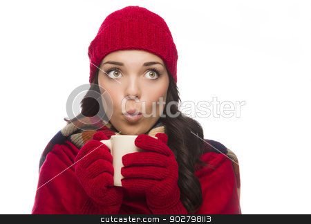 Mixed Race Woman Wearing Mittens Holds Mug Looks to Side stock photo, Happy Mixed Race Woman Wearing Winter Hat and Gloves Holds a Mug Isolated on White Background Looking to the Side. by Andy Dean