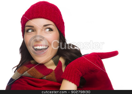 Mixed Race Woman Wearing Mittens and Pointing to the Side stock photo, Happy Mixed Race Woman Looks and Points to the Side Wearing Winter Hat and Gloves Isolated on White Background. by Andy Dean