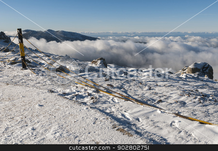 snowy summit stock photo, snowy summit with mountains between clouds by OHphoty
