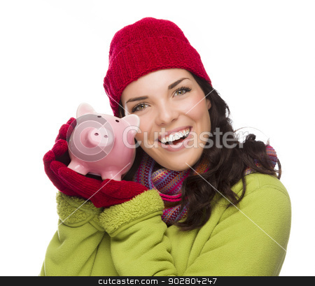 Happy Mixed Race Woman Wearing Winter Hat Holding Piggybank stock photo, Happy Smiling Mixed Race Woman Wearing Winter Clothing Holding Piggybank Isolated on White Background. by Andy Dean