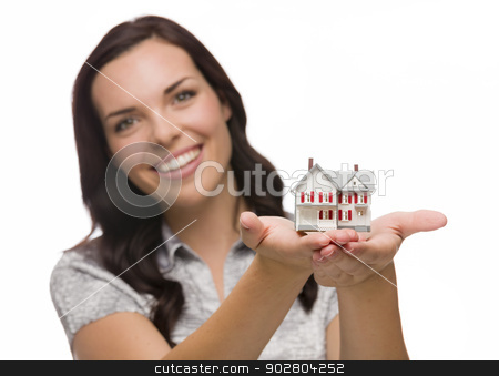 Happy Mixed Race Woman Holding Small House Isolated on White stock photo, Mixed Race Woman Holding Small House Isolated on White Background - Focus is On The House. by Andy Dean