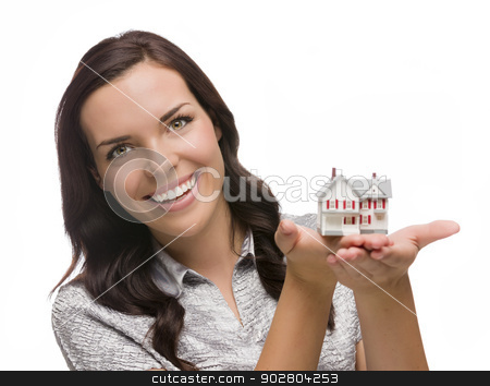 Smiling Mixed Race Woman Holding Small House Isolated on White stock photo, Mixed Race Woman Holding Small House Isolated on White Background. by Andy Dean