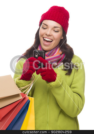 Mixed Race Woman Holding Shopping Bags Texting On Cell Phone  stock photo, Mixed Race Woman Wearing Winter Clothing Holding Shopping Bags Texting On Cell Phone Isolated on White Background. by Andy Dean