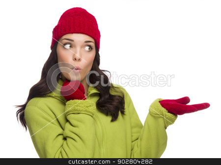Mixed Race Woman Wearing Hat and Gloves Gesturing to Side stock photo, Beautiful Mixed Race Woman Wearing Winter Hat and Gloves Isolated on a White Background Gesturing with Her Hand to the Side. by Andy Dean