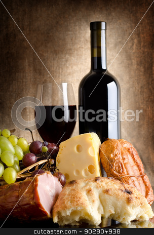 Abundance stock photo, Wine, cheese, grapes and sausage on an old canvas by Givaga